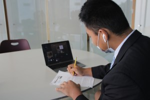 A student listens to Spotify while doing school work