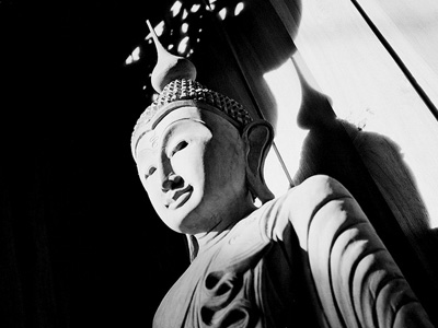 Black and white image of a Buddha statue.