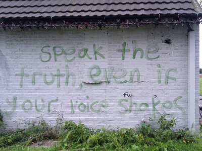 """Speak the truth even if your voice shakes"" painted on a wall."