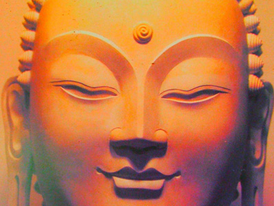 The golden color face of the buddha.