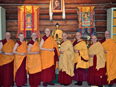 The current 10 Abbey monastics, standing together in the meditation hall.