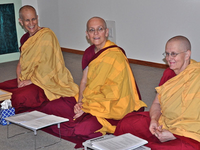 Venerables Chodron, Semkye and Jigme sitting together.