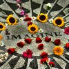 A peace sign made of flowers over the 'Imagine' John Lennon memorial in Central Park.