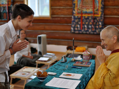 Young Abbey retreatant bowing to Venerable Chodron.