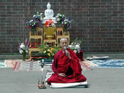Venerable Chodron in front of altar, teaching.