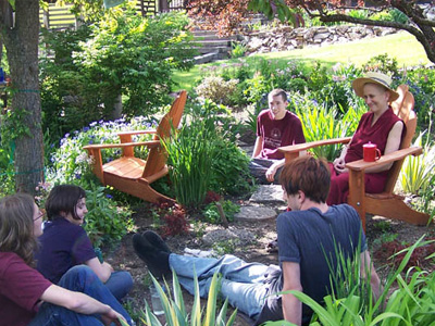 Venerable Chodron outside in a discussion with a group of youth.