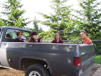 A group of young adult retreatants in back of the abbey truck.
