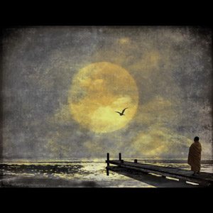 A monk standing on a walkway, looking at the full moon.