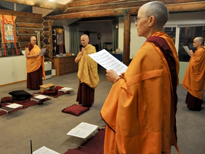 Venerable Chodron and other monastics in the meditation hall during the 2014 Pravarana ceremony.