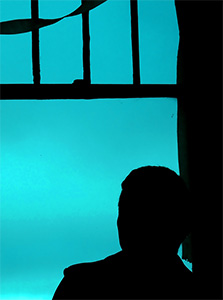 Man looking out window.