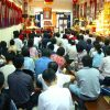 Students seated, listening to Venerable give a Dharma talk.