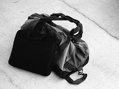 Duffel bag sitting on the ground.