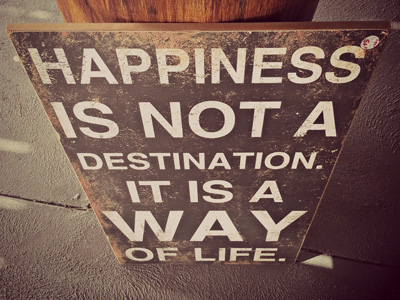 A signboard with the words: Happiness in not a destination. It is a way of life.