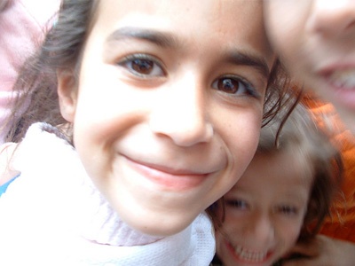 Closeup of a smiling Iraqi girl.
