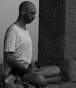 Man sitting in meditation.