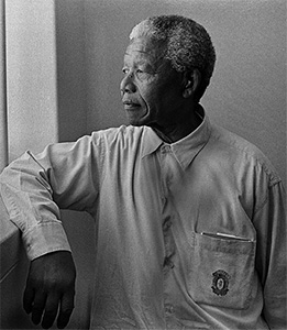 Nelson Mandela looking out prison window.
