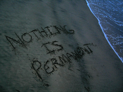 Someone wrote the words Nothing is permanent on the sand.