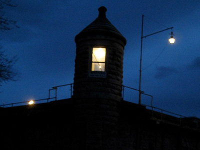 Silhouette of guard station atop Oregon State Penitentiary.