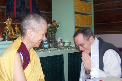 Kevin kneeling in respect to Venerable Chodron.