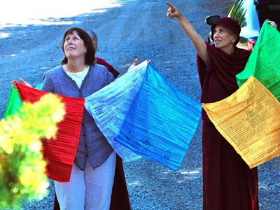 Tracy helping raise prayer flags at the Abbey.