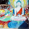 Colorful mural on Vajrasattva on a building in Mexico.