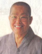 Photo of Venerable Sek Fatt Kuan, smiling.