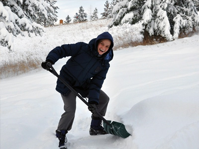 Venerable Jampa shoveling snow.