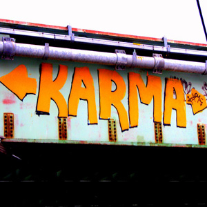 A bridge with the words KARMA written in orange color.