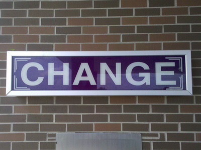 A sign on the wall that says 'Change'.