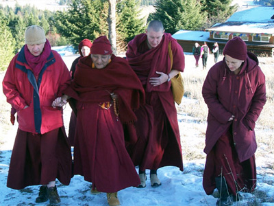 Venerable Chogkyi walking with the sangha.