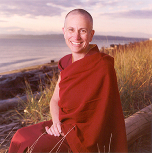 Venerable Chodron sitting by the ocean.