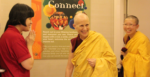 Ven. Chodron smiling and entering the centre with Ven. Damcho.