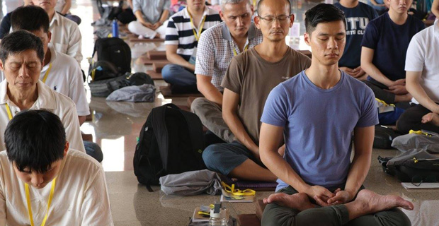 Students sitting in meditative posture.