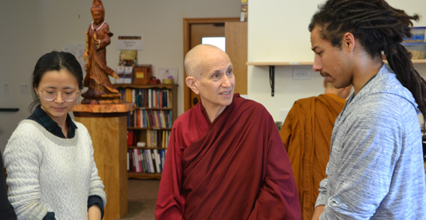 Ven. Chodron talking to a lay volunteer.