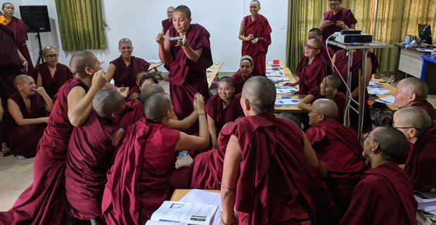 Tibetan nuns discussing physics experiments in class.
