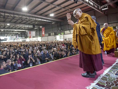 His Holiness waving to audience of many people.