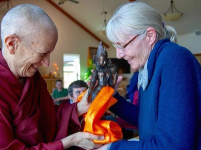 Venerable Chodron offering a gift to a student at the Abbey.