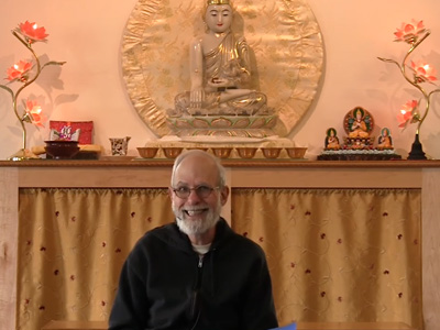 Bob giving a talk at Sravasti Abbey in front of the Chenrezig Hall altar.