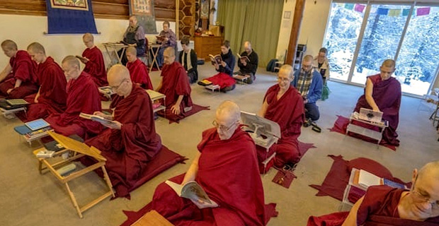 A group of monastics and laypeople practicing in the meditation hall at Sravasti Abbey.