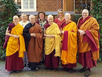 Venerable Chodron standing with monastics and lay people at Shide Nunnery.