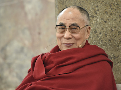 His Holiness looking at the camera and smiling.