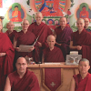 Sravasti Abbey monastics standing together in a group.