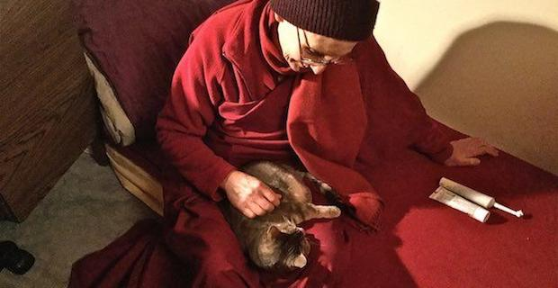 Venerable Tsepal with Mudita the cat in her lap.