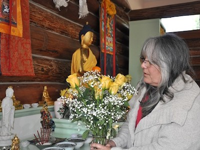 Cheri standing in front of the altar, offering yellow roses.