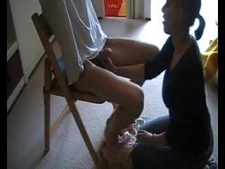 Slave boy handcuffed dominated by a vicious slut