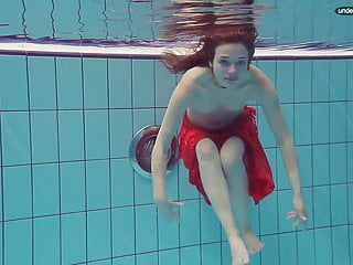 Libuse goes underwater within the pool