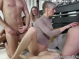 Gang of grannies devours a pair of large younger exhausting cocks