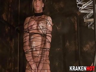 Muscled woman tied up sucking in a BDSM scene