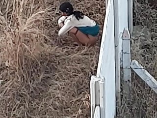 Indian slut out of doors pissing