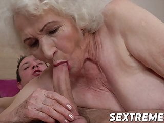 Tantalizing sexy mom convinces younger boy with cock sucking and bang